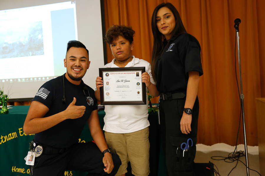 Luis Garcia, center, is presented with the Heroism Certificate by Matthew Velez and Diana Tarango, members of the Culberson County Emergency Response Team. -Photo courtesy of EPISD