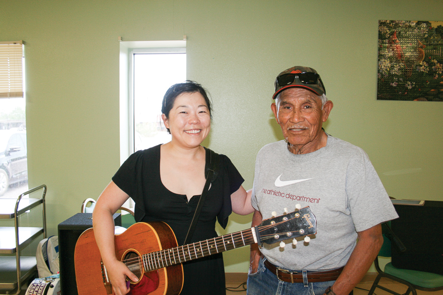 Betty Soo TCA artist pictured with Felipe Martinez of Van Horn at the local Nutrition Center.