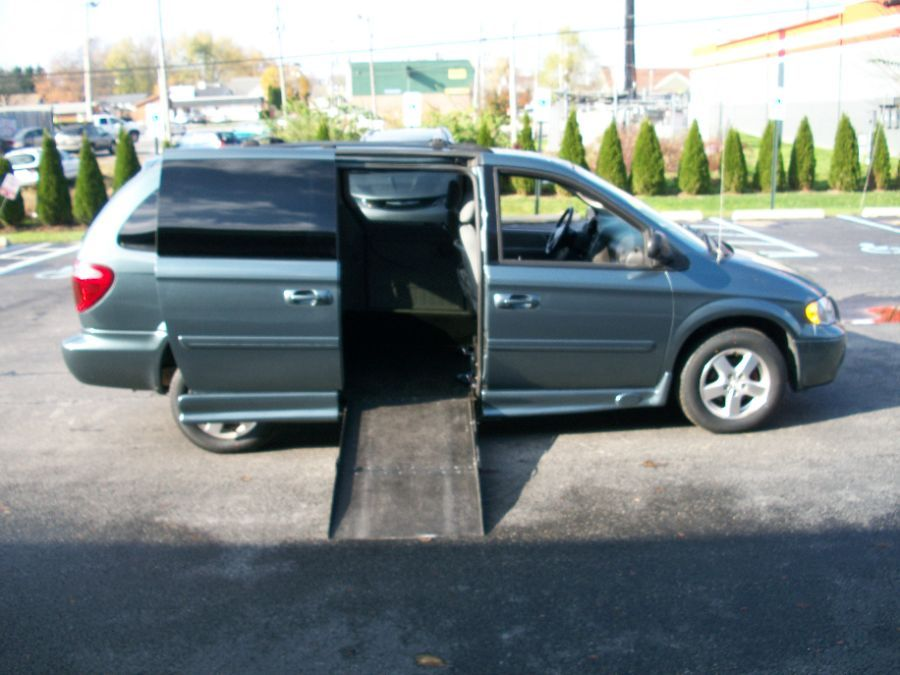 Green Dodge Grand Caravan with Side Entry Automatic Fold Out ramp