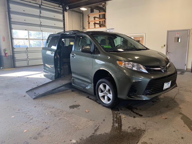 Green Toyota Sienna with Side Entry Automatic Fold Out ramp