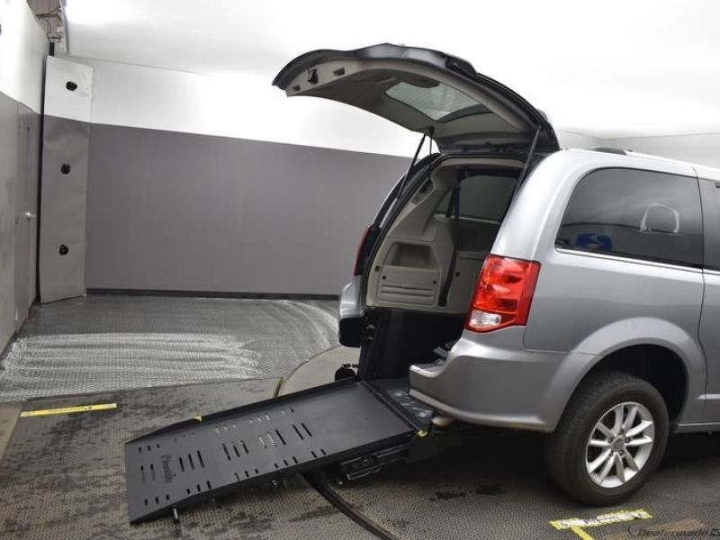 Silver Dodge Grand Caravan with Rear Entry Manual Fold Out ramp