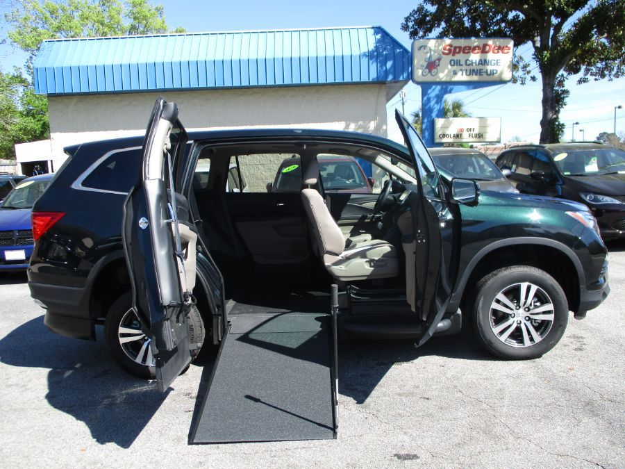 Green Honda Pilot with Side Entry Manual In Floor ramp
