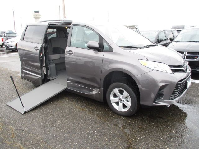 Gray Toyota Sienna with Side Entry Manual In Floor ramp