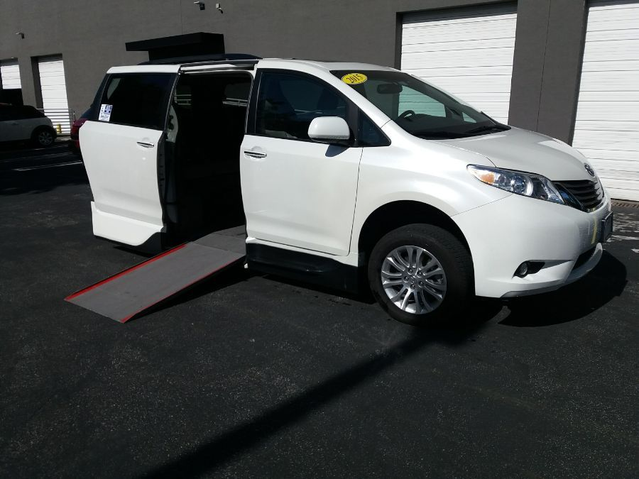 White Toyota Sienna with  Automatic In Floor ramp