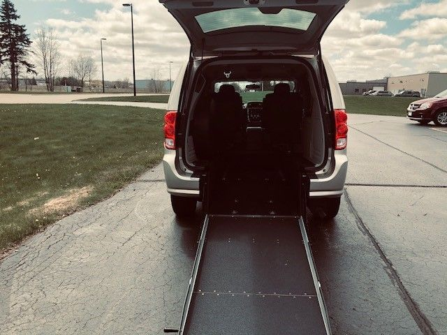 Brown Dodge Grand Caravan with Rear Entry Manual Fold Out ramp