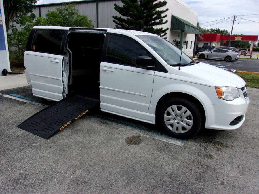 White Dodge Grand Caravan with Side Entry Manual Fold Out ramp