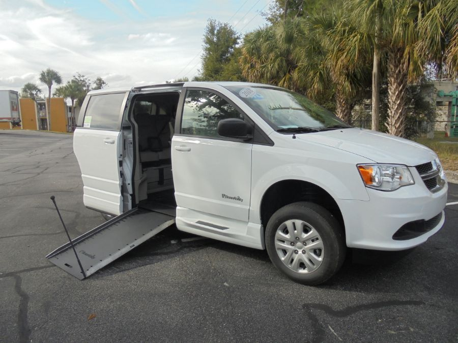 White Dodge Grand Caravan with Side Entry Manual In Floor ramp