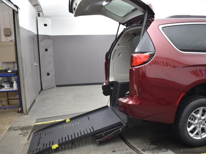 Red Chrysler Voyager with Rear Entry Manual Fold Out ramp