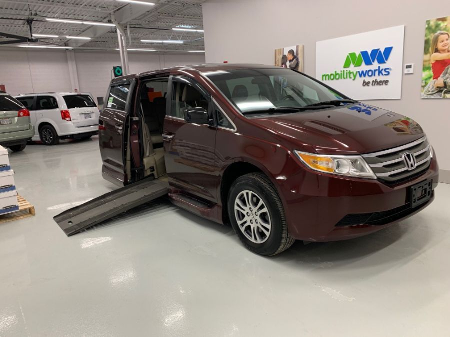 Red Honda Odyssey with Side Entry Automatic Fold Out ramp