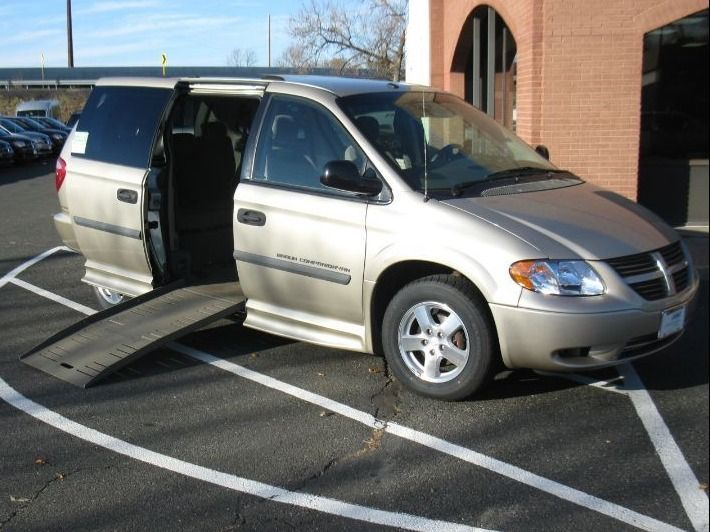 Brown Dodge Grand Caravan with Side Entry Manual Fold Out ramp