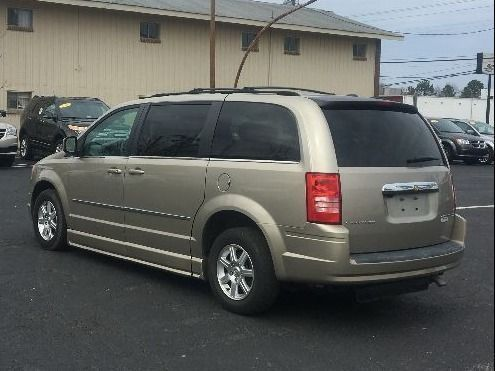 Gold Chrysler Town and Country image number 10