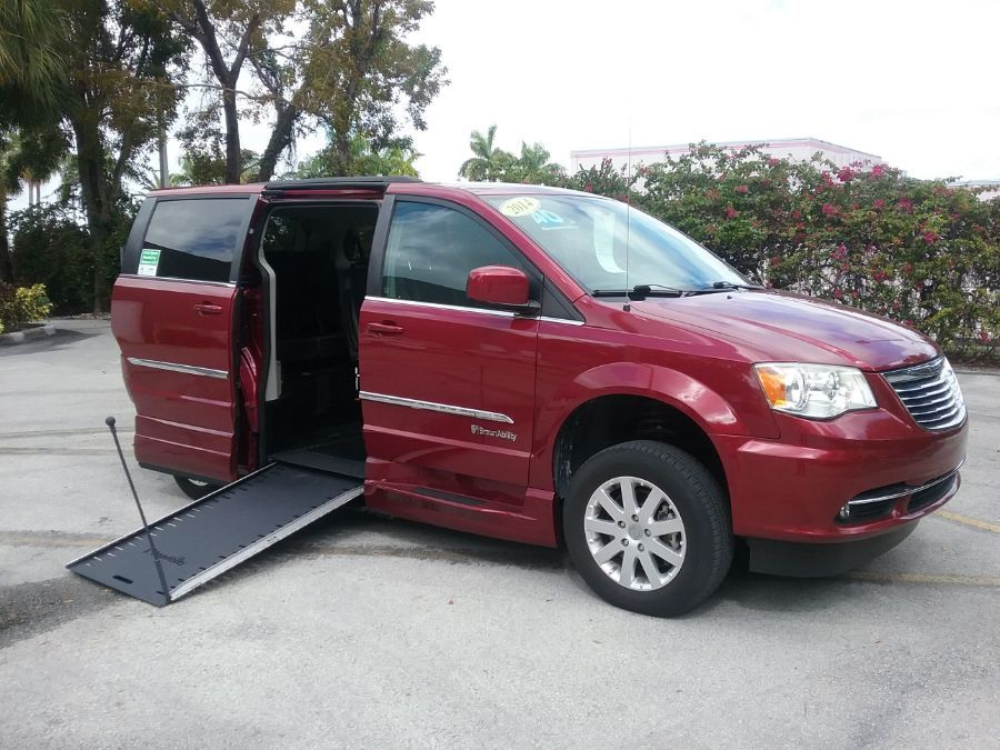 Red Chrysler Town and Country with Side Entry Manual In Floor ramp