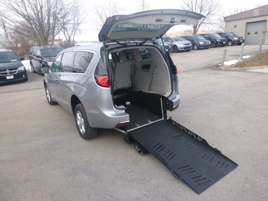 Silver Chrysler Pacifica Hybrid with Rear Entry Manual Fold Out ramp