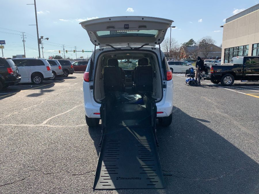 White Chrysler Voyager with Rear Entry Manual Fold Out ramp