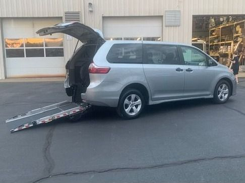 Silver Toyota Sienna with Rear Entry Manual Fold Out ramp