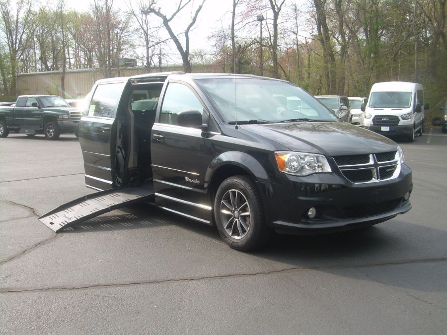 Black Dodge Grand Caravan with Side Entry Manual Fold Out ramp