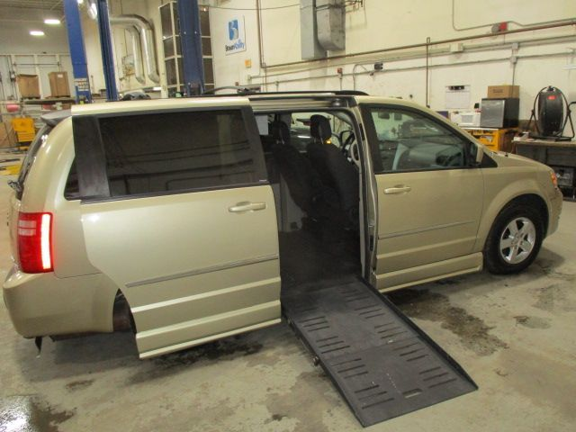 Gold Dodge Grand Caravan with Side Entry Automatic Fold Out ramp