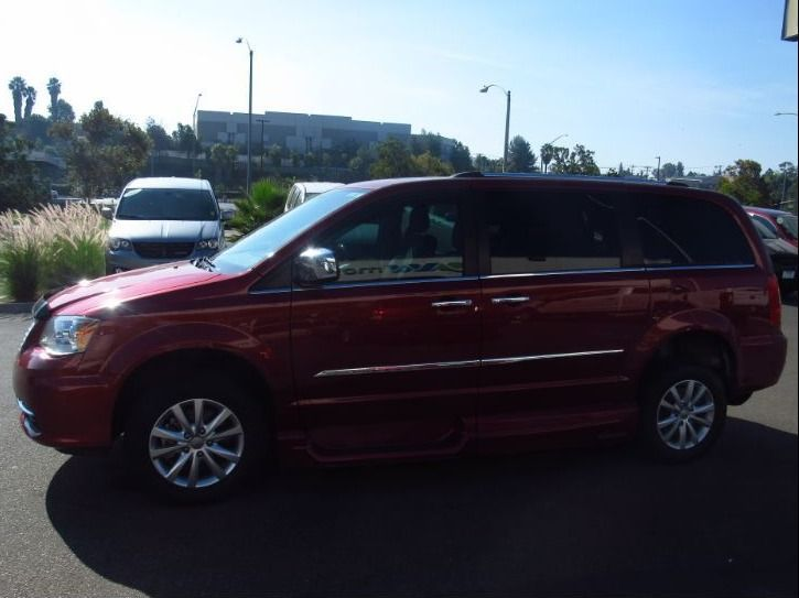 Red Chrysler Town and Country image number 4