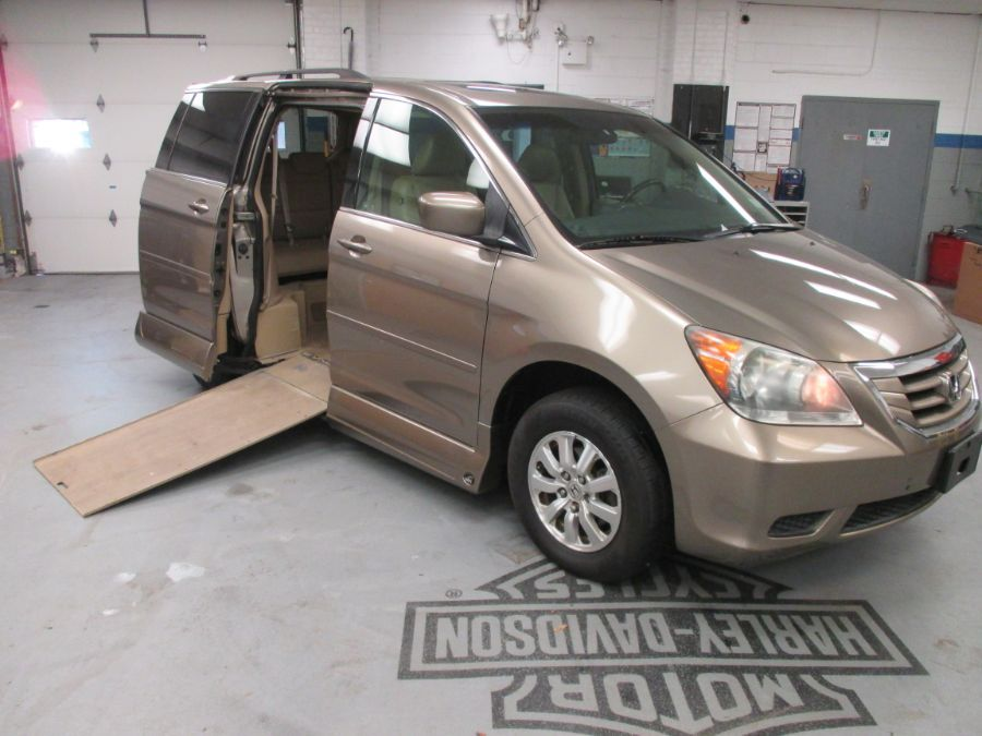 Gold Honda Odyssey with Side Entry Automatic In Floor ramp