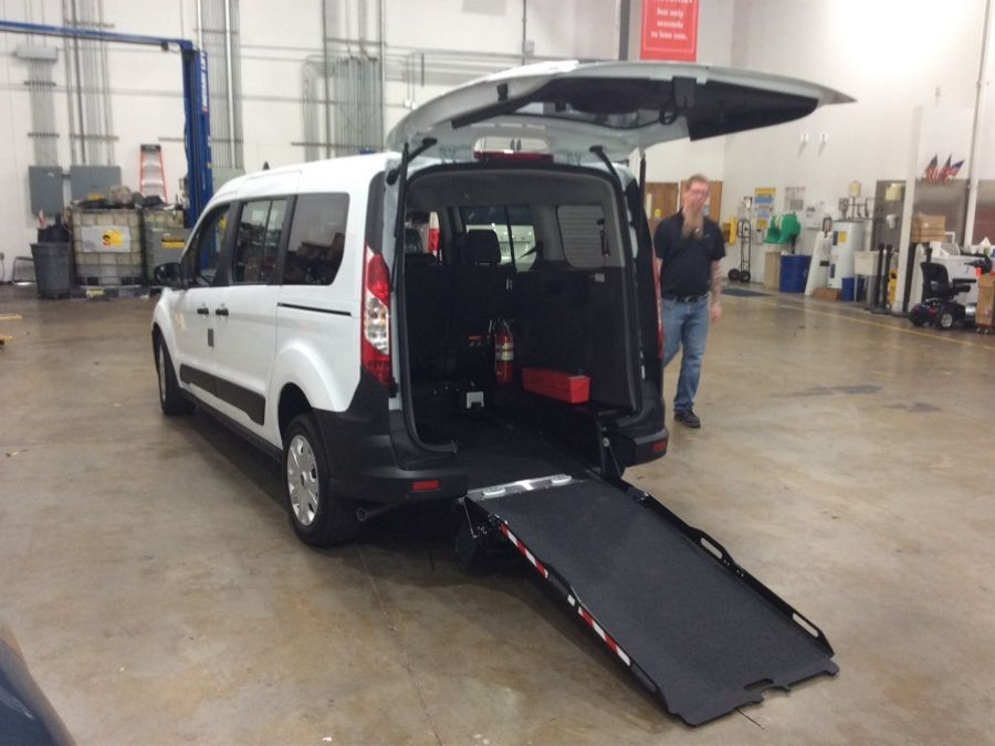 White Ford Transit Connect with Rear Entry Manual Fold Out ramp