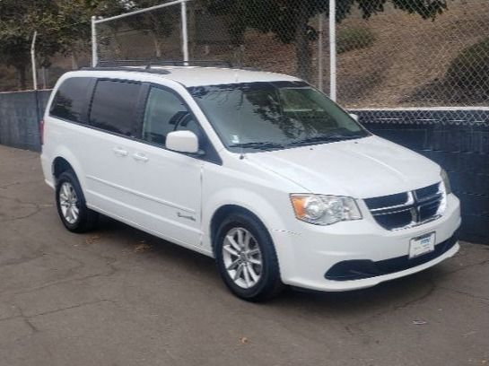 White Dodge Grand Caravan with Rear Entry Automatic Fold Out ramp