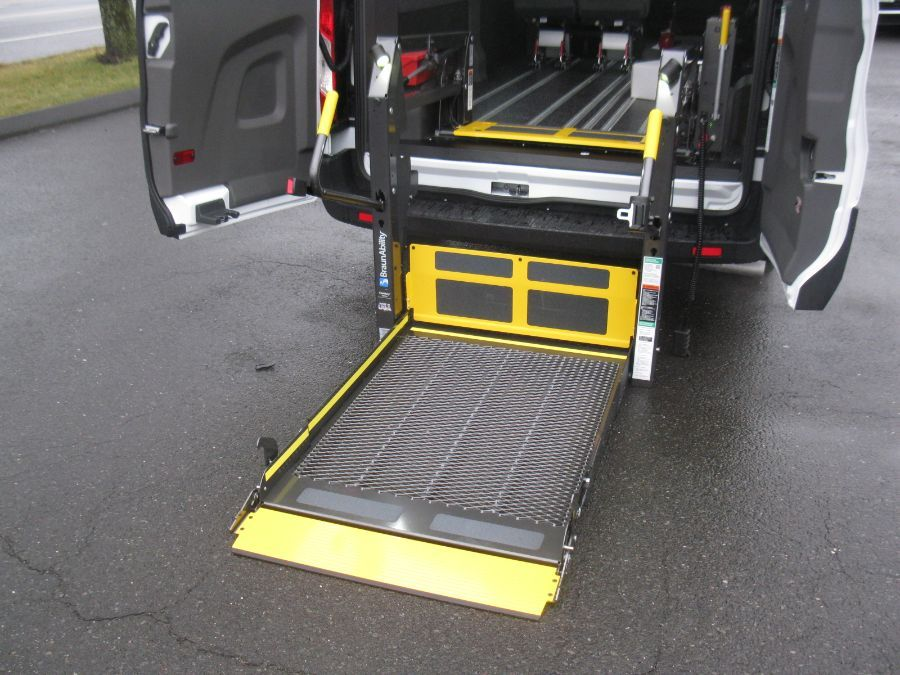 Blue Ford T150 with Rear Entry Automatic Fold Out ramp