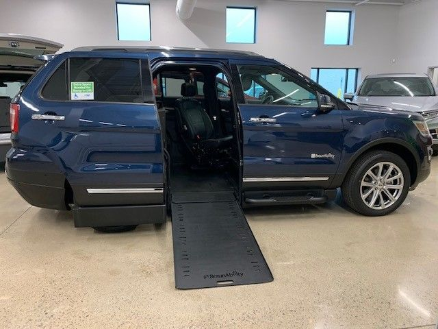 Blue Ford Explorer with Side Entry Automatic In Floor ramp