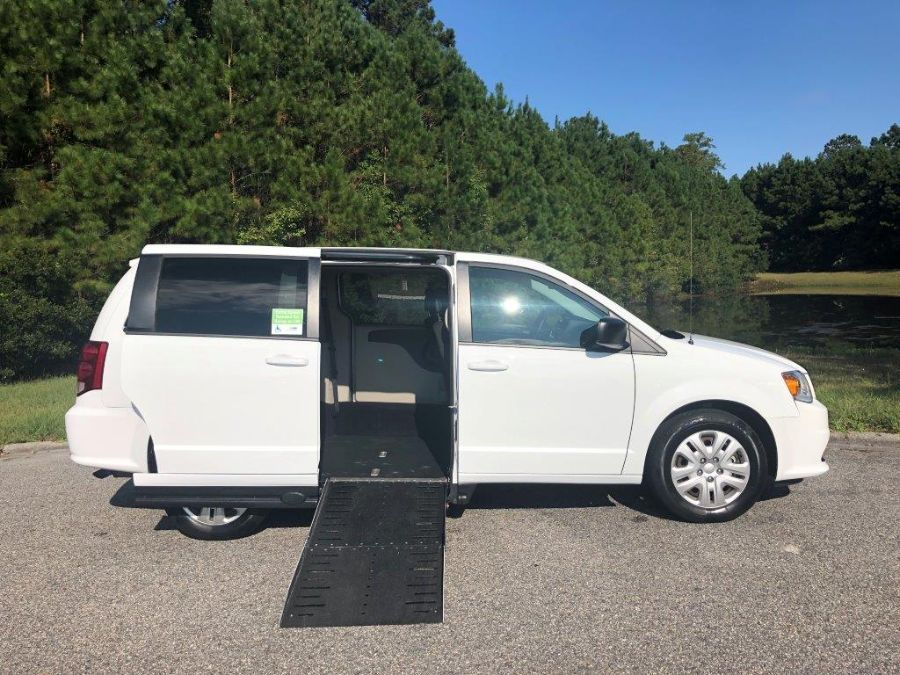 White Dodge Grand Caravan with  Automatic Fold Out ramp