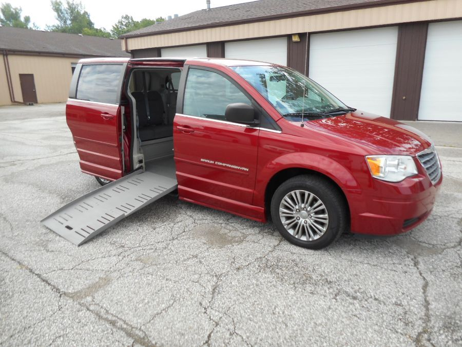 Red Chrysler Town and Country with Side Entry Manual Fold Out ramp