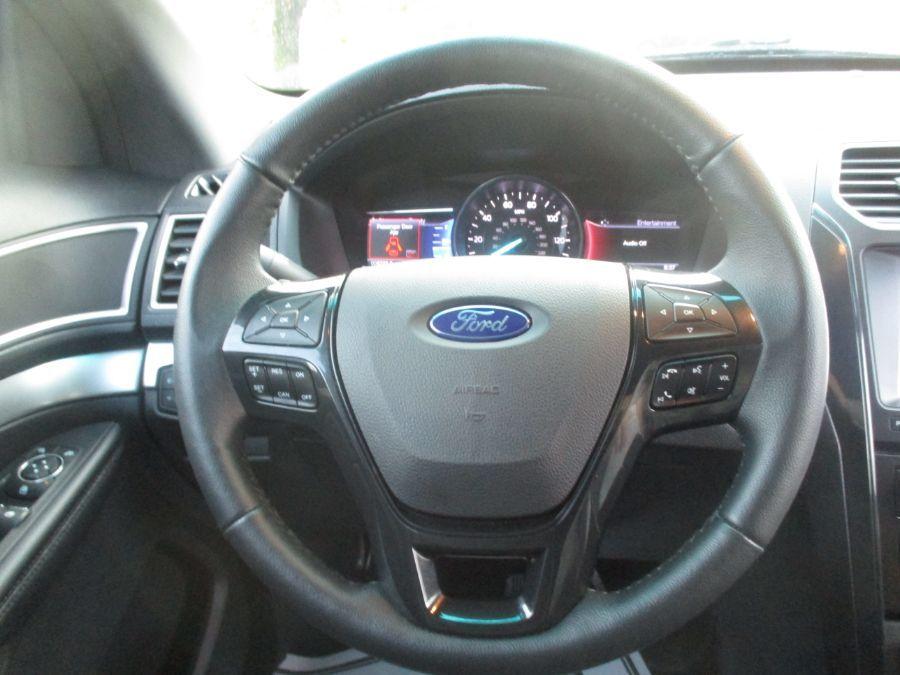 Black Ford Explorer image number 7