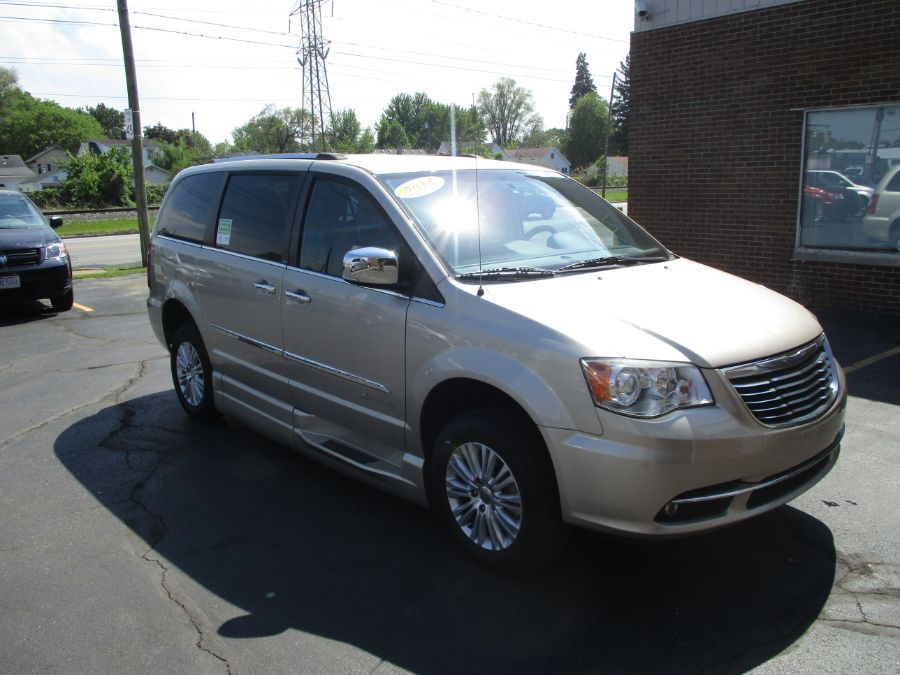 Gold Chrysler Town and Country image number 15
