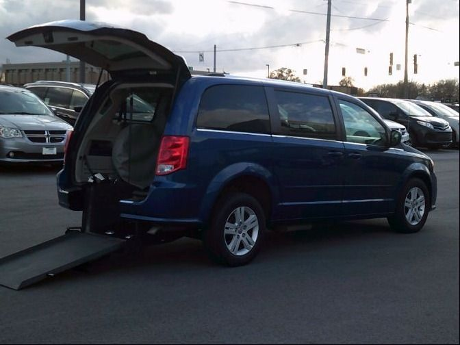 Blue Dodge Grand Caravan with Rear Entry Automatic Fold Out ramp