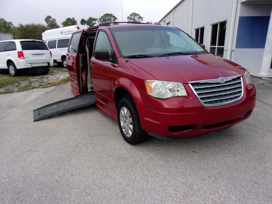 Red Chrysler Town and Country with Side Entry Automatic Fold Out ramp