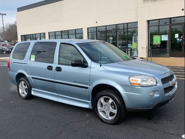 Blue Chevrolet Uplander with Side Entry Manual Fold Out ramp