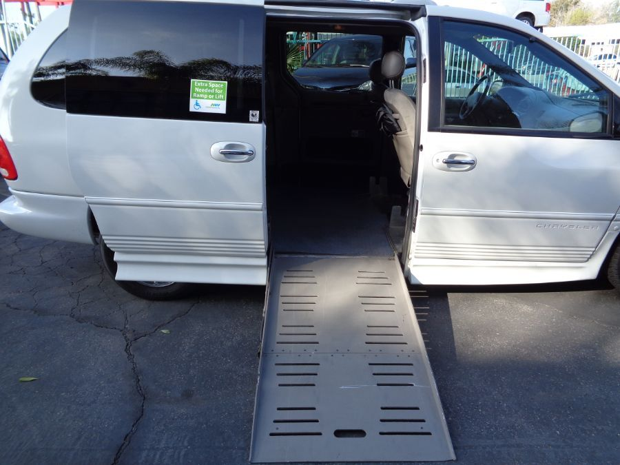 White Chrysler Town and Country with Side Entry Automatic Fold Out ramp