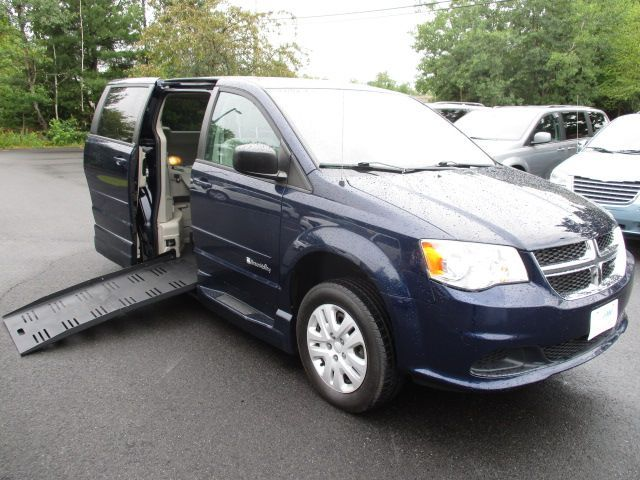 Blue Dodge Grand Caravan with Side Entry Automatic Fold Out ramp