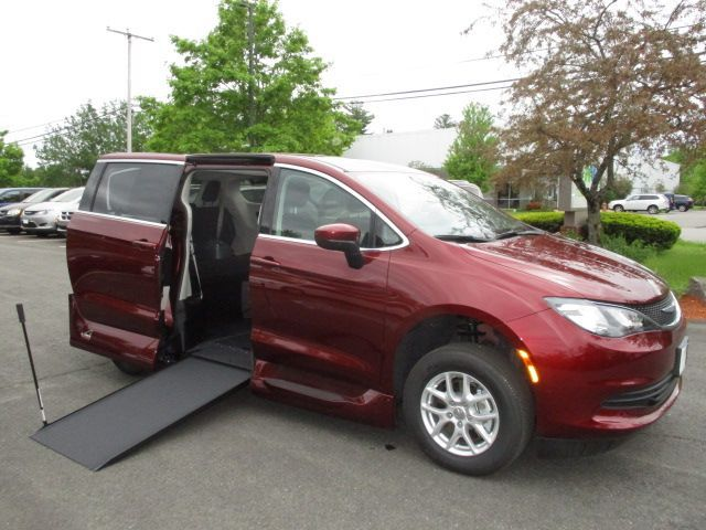 Red Chrysler Voyager with Side Entry Manual In Floor ramp