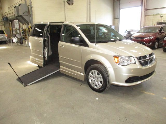 Gold Dodge Grand Caravan with Side Entry Manual In Floor ramp