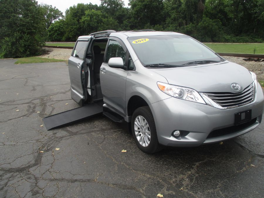 Silver Toyota Sienna with  Automatic In Floor ramp