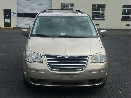 Gold Chrysler Town and Country image number 13