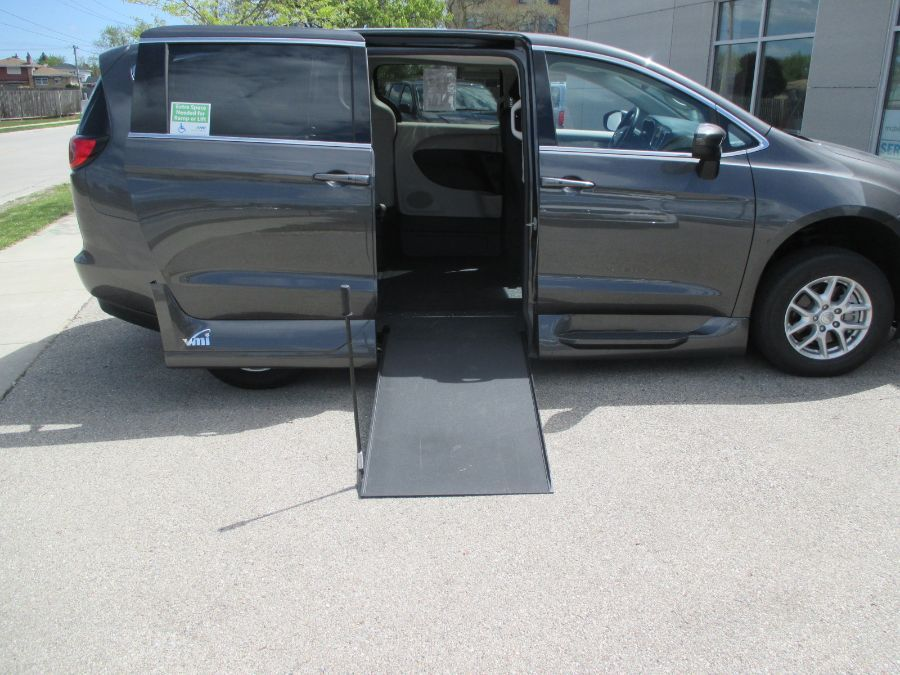 Gray Chrysler Voyager with Side Entry Manual In Floor ramp