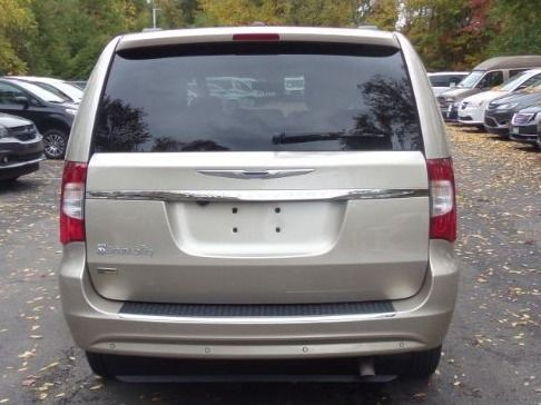 Gold Chrysler Town and Country image number 4