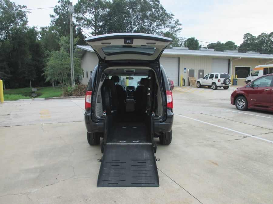 Gray Chrysler Town and Country with Rear Entry Manual Fold Out ramp