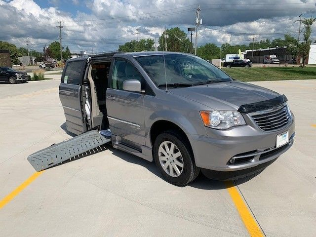 Silver Chrysler Town and Country with Side Entry Automatic Fold Out ramp