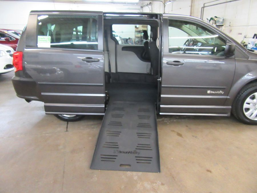 Gray Dodge Grand Caravan with Side Entry Manual Fold Out ramp