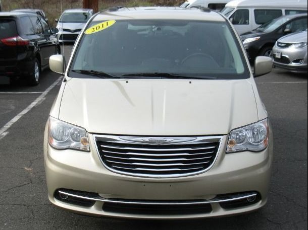 Gold Chrysler Town and Country image number 1