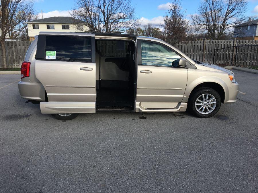 Gold Dodge Grand Caravan image number 1