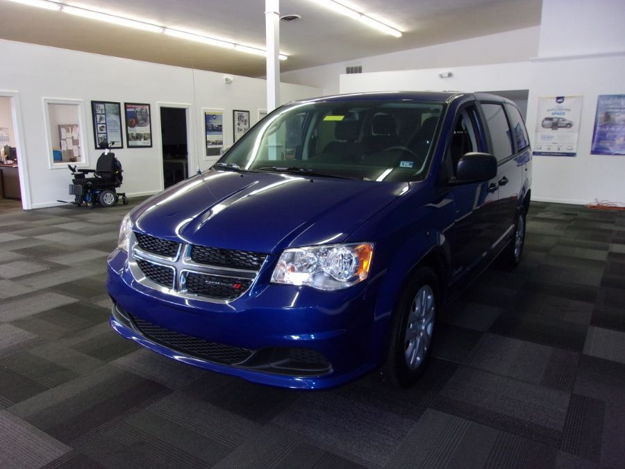 Blue Dodge Grand Caravan with Rear Entry Manual Fold Out ramp