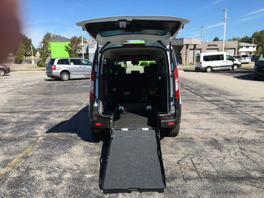White Ford Transit Connect Wagon with Rear Entry Manual Fold Out ramp