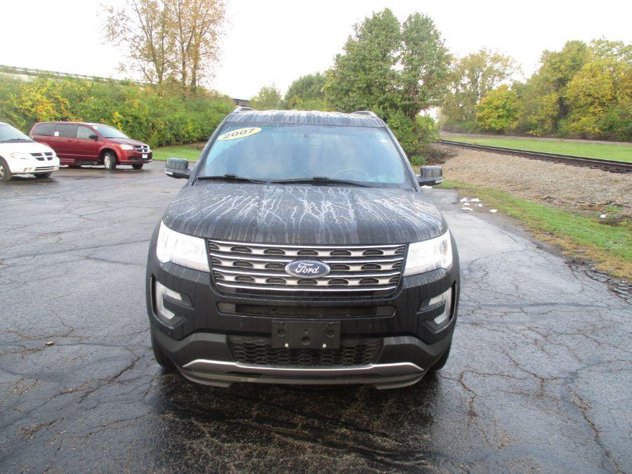 Black Ford Explorer image number 1